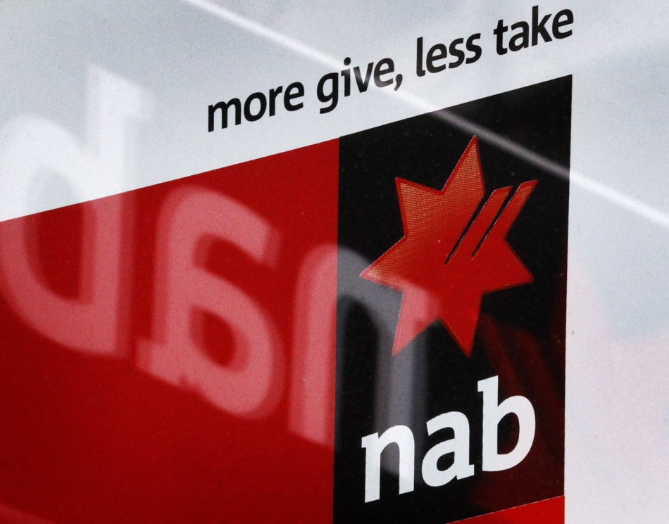 A National Australia Bank sign is reflected in the window of a shop front in Sydney