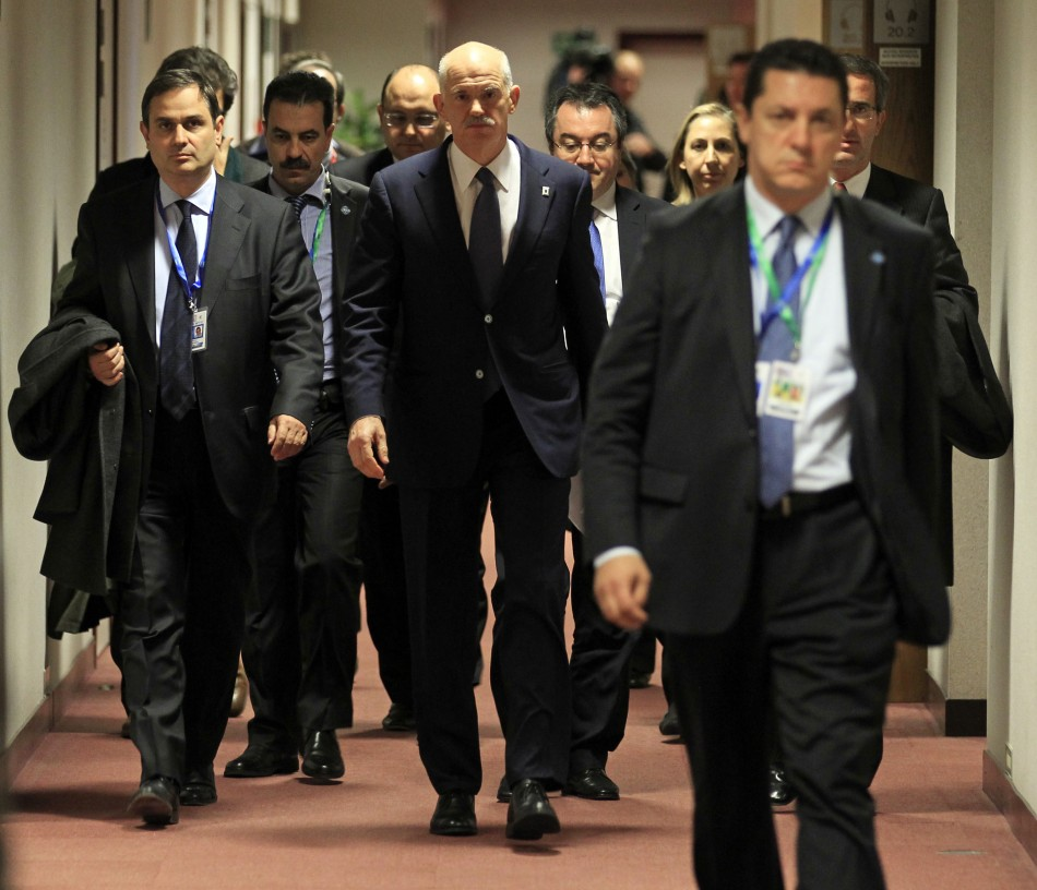 Greece's Prime Minister George Papandreou arrives at a news conference at the end of a euro zone summit in Brussels
