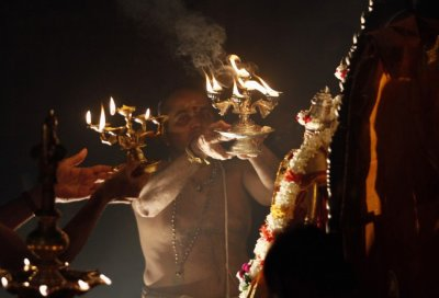 A Hindu priest makes a blessing during the festival of Diwali at Shivm Kovi temple in Colombo