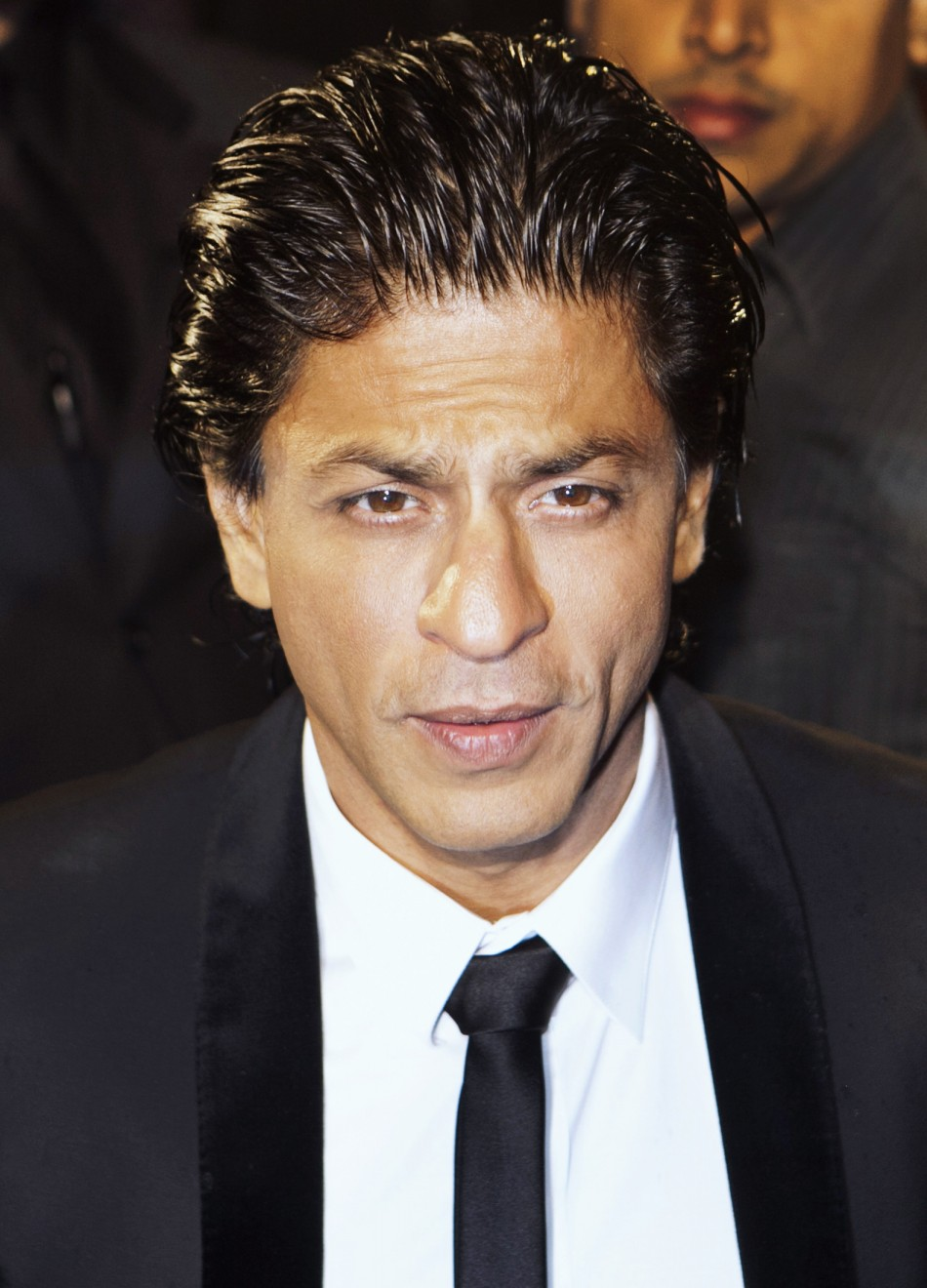 "Actor Khan of India arrives on the red carpet for the premiere of ""Ra One"" in Toronto"