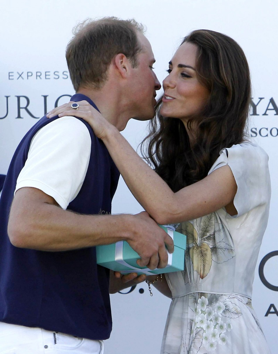 Catherine, Duchess of Cambridge, kisses her husband following a polo match at the Santa Barbara Polo and Racquet Club