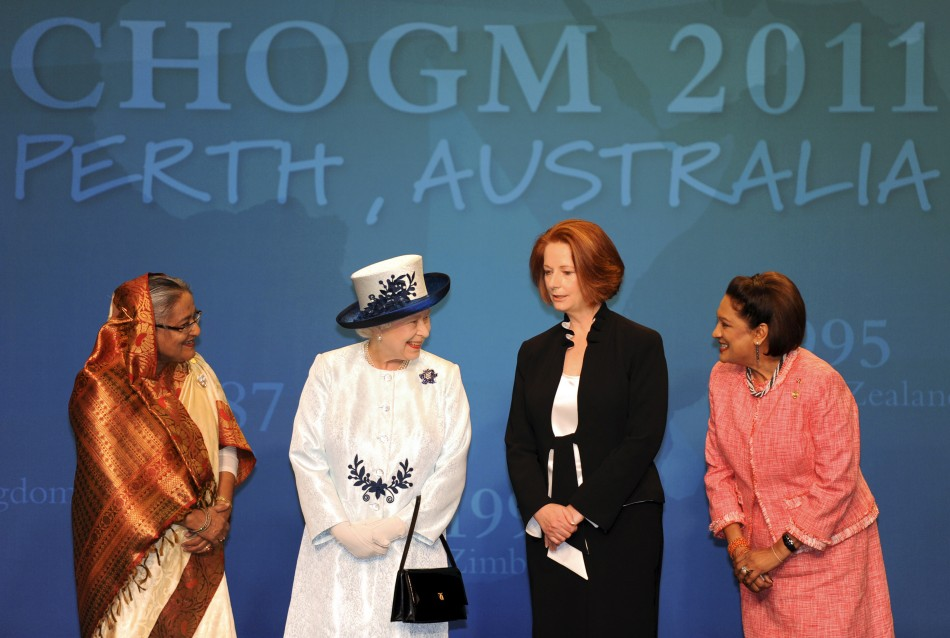Britain's Queen Elizabeth smiles next to Bangladesh's PM Sheikh Hasina, Australia's PM Julia Gillard and Trinidad and Tobago's PM Kamla Persad-Bissessar at CHOGM in Perth