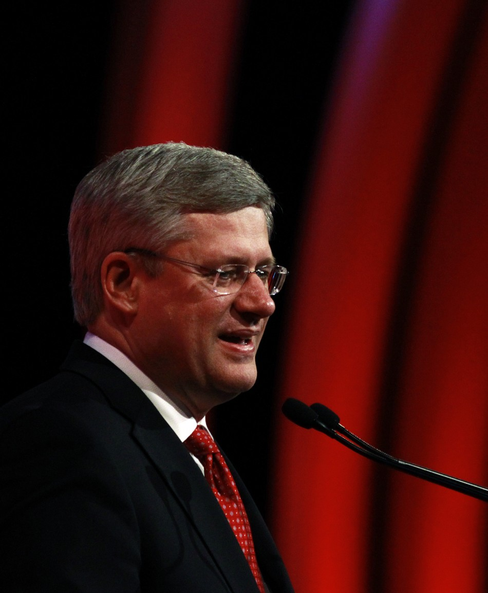 Canada's PM Stephen Harper gives a speech during the concluding session at a pre-summit business forum ahead of the CHOGM in Perth
