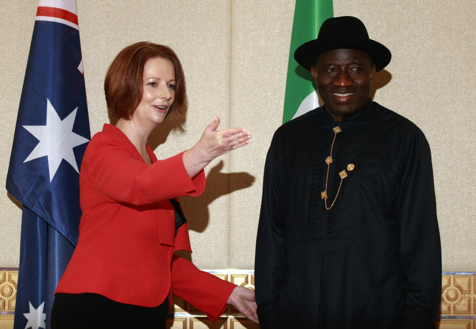 Australian Prime Minister Gillard gestures to Nigerian President Jonathan during a bilateral summit ahead of CHOGM in Perth