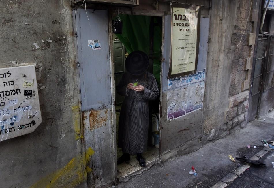 An ultra-Orthodox Jewish man checks an etrog at a market in Jerusalem's Mea Shearim neighbourhood