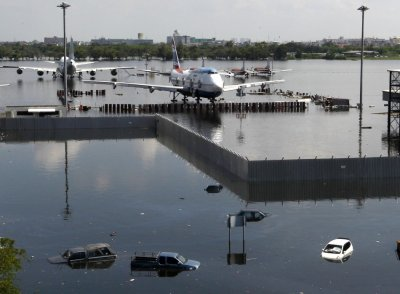 Airplanes are seen parked on the flooded tarmac at Don Muang airport in Bangkok