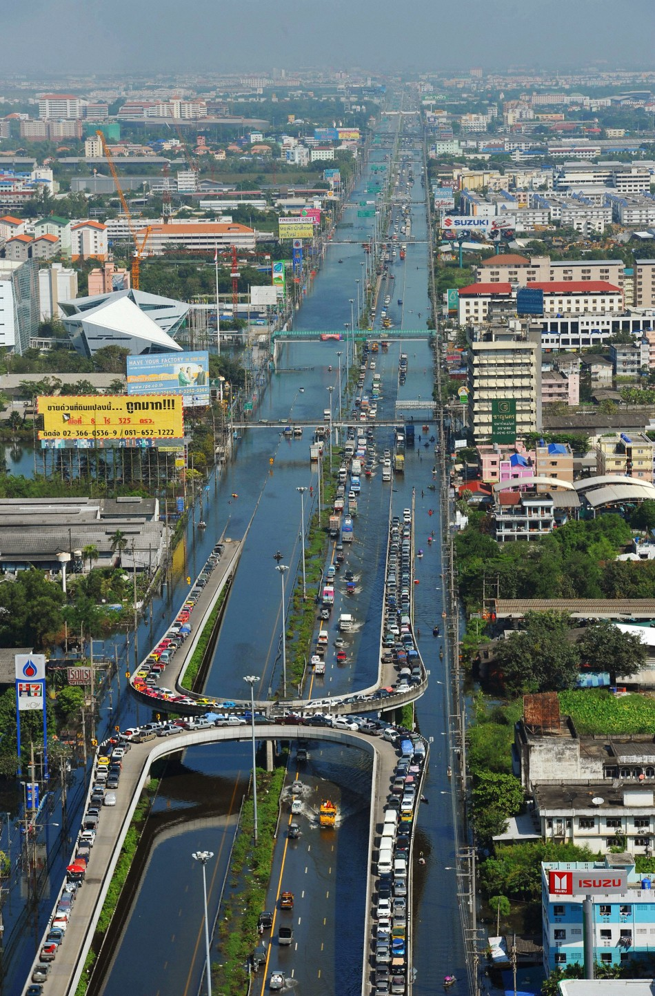 An aerial view shows cars parked on the flyovers to avoid the floodwaters in the northern part of Bangkok