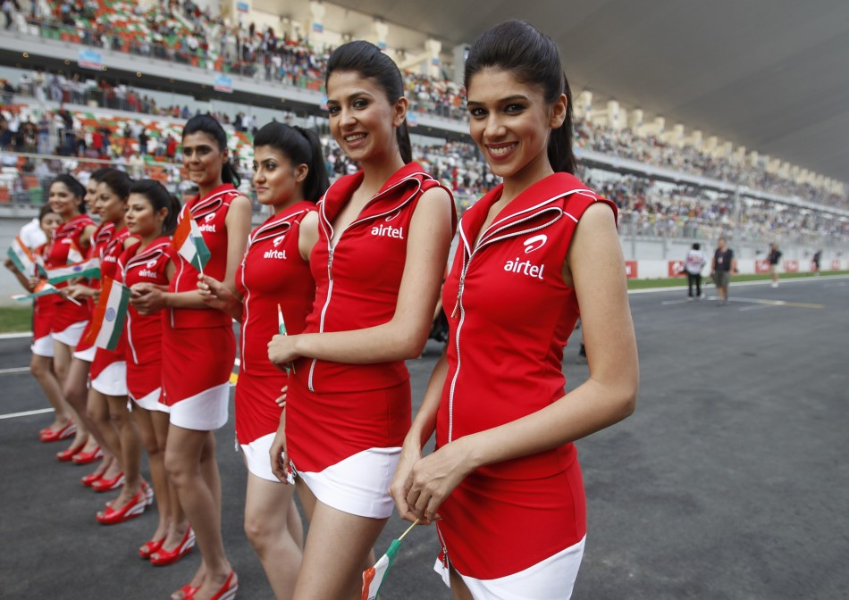 F1 Grid girls pose before the Indian first Formula One Grand Prix at the Buddh International Circuit in Greater Noida