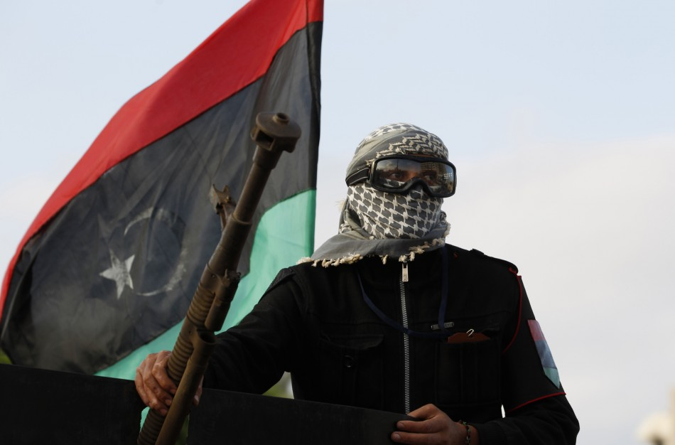 An anti-Gaddafi fighter returning from Sirte is welcomed in Misrata
