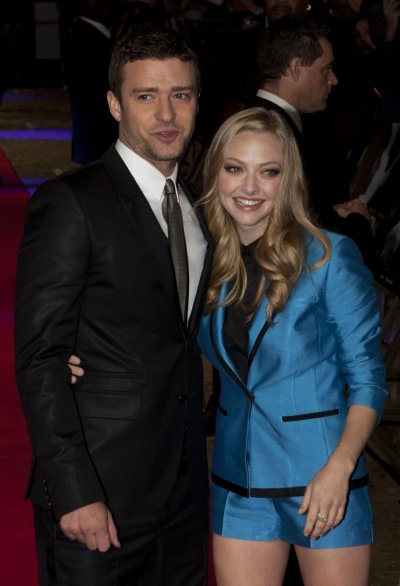 Justin Timberlake L and Amanda Seyfried pose for photographers at the British premiere of the film quotIn Timequot at the Curzon Mayfair cinema in London October 31, 2011