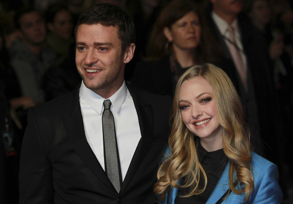 "Justin Timberlake (L) and Amanda Seyfried pose for photographers at the British premiere of the film ""In Time"" at the Curzon Mayfair cinema in London October 31, 2011"
