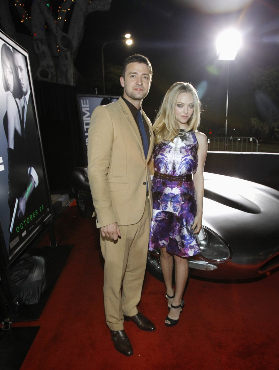 "Cast members Justin Timberlake and Amanda Seyfried pose at the premiere of ""In Time"" at the Regency Village Theatre in Westwood, California October 20, 2011. The movie opens in the U.S. on October 28."