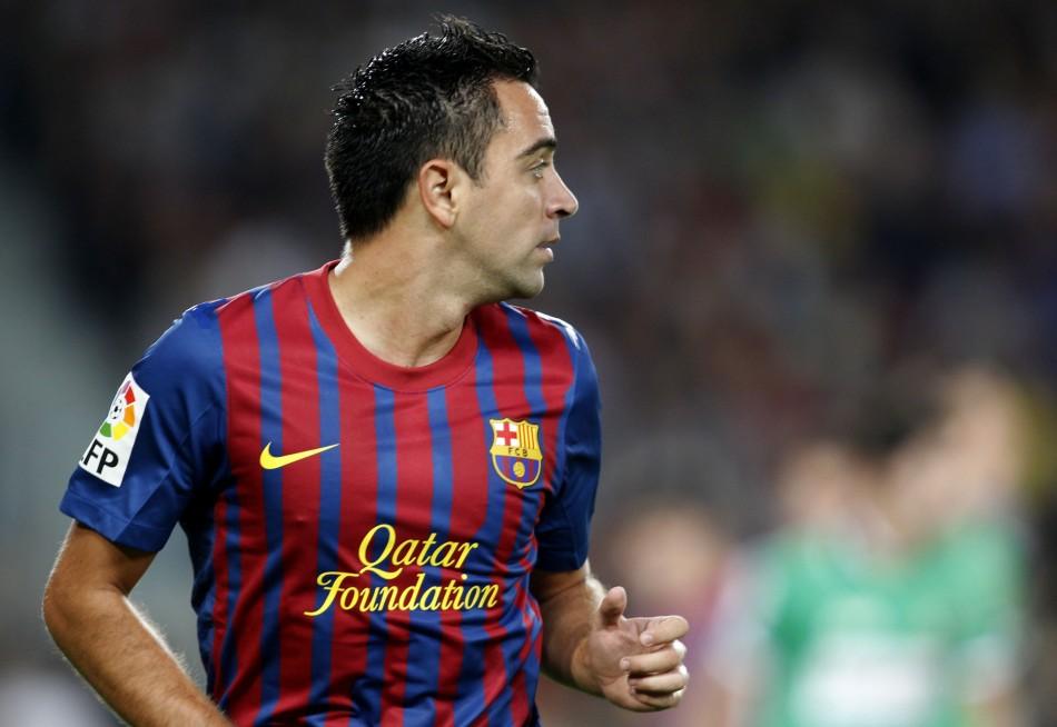 Reuters: Xavi Hernandez (Barcelona and Spain)