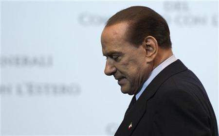 Italy Prime Minister Silvio Berlusconi leaves at the end of a meeting in Rome