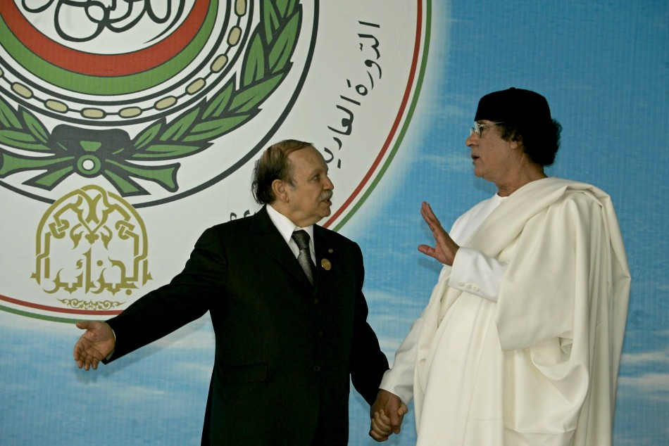 Algerian President Abdelaziz Bouteflika talks to Libya's Muammar Gaddafi  ...