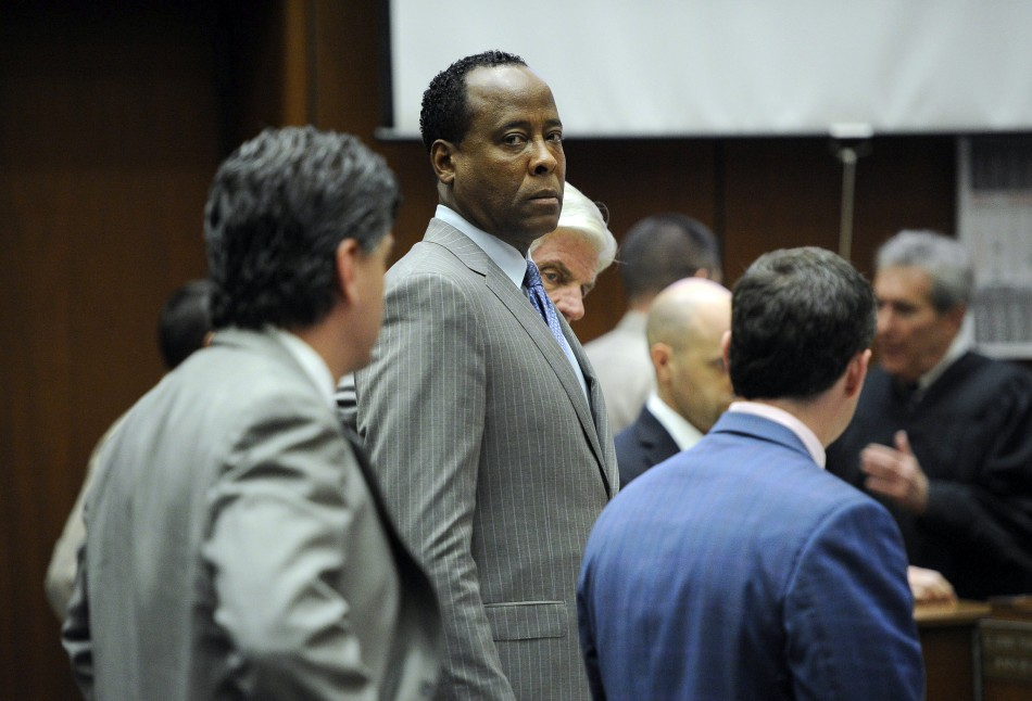 Dr. Conrad Murray stands with his attorneys in the courtroom after the defense rested its case during his trial in the death of pop star Michael Jackson in Los Angeles