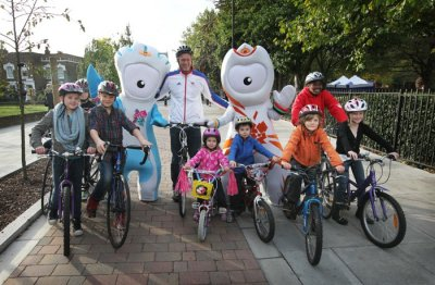 Olympian Mark Foster, the London 2012 mascots Wenlock and Mandeville and local children help launch a series of upgraded cycle and walking routes across London on Oct. 24, 2011.