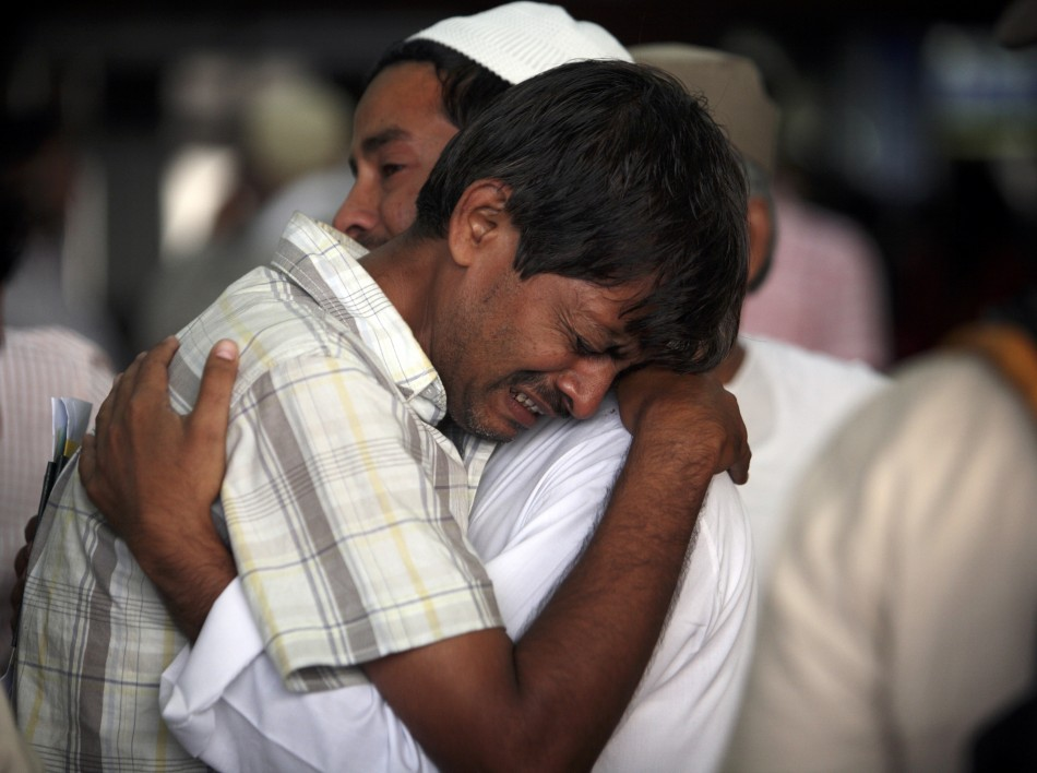 Hajj pilgrims cry as they prepare to depart for Mecca from the Tribhuvan International Airport in Kathmandu 18/10/2011