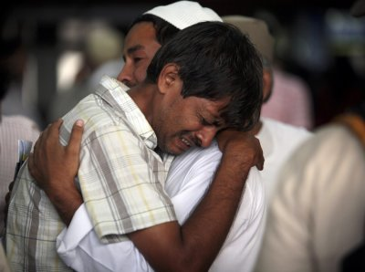 Hajj pilgrims cry as they prepare to depart for Mecca from the Tribhuvan International Airport in Kathmandu 18102011
