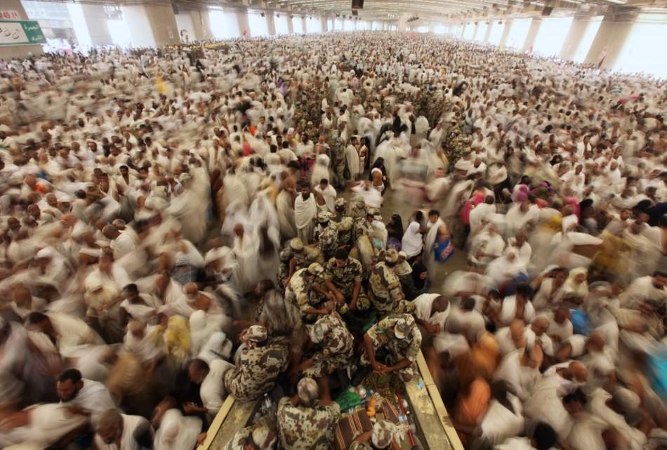 Muslim pilgrims gather to cast stones at pillars symbolising Satan in Mena