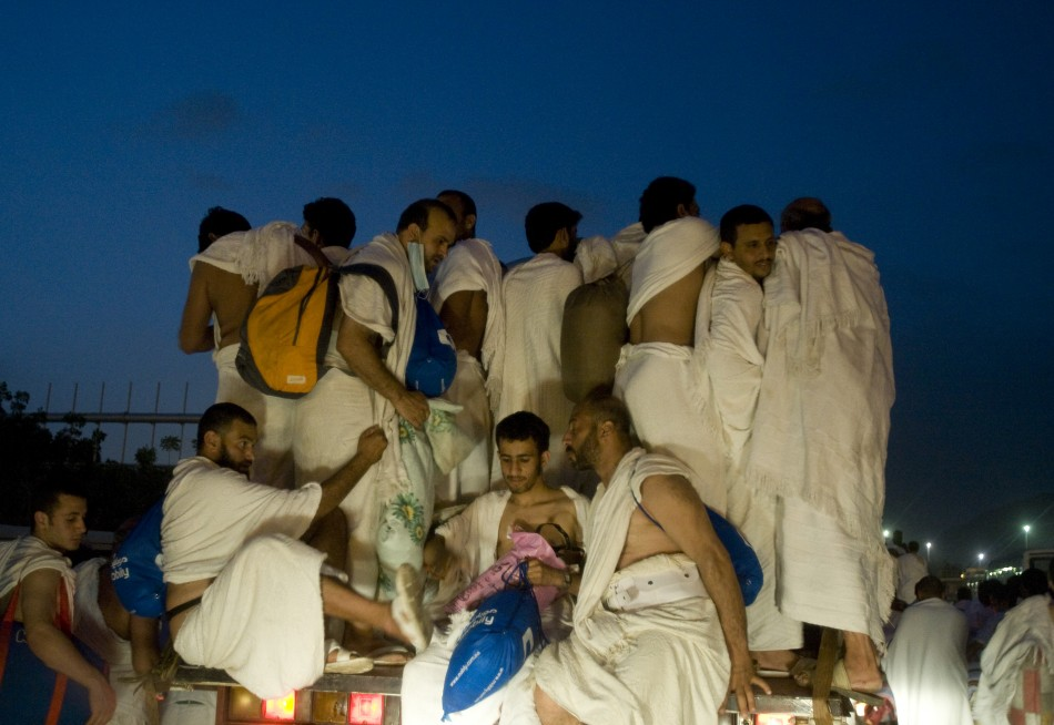 Muslim pilgrims catch a ride on a truck from the plains of Arafat outside the holy city of Mecca to Muzdalifa during the haj pilgrimage