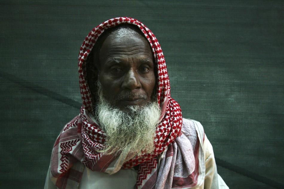 Muslim pilgrim stands outside Grand Mosque in Mecca
