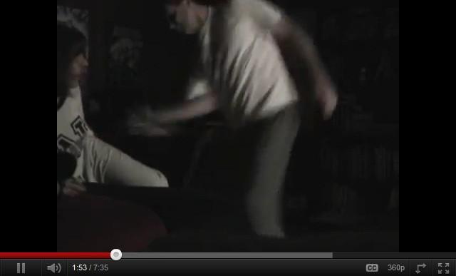 William Adams beating his daughter