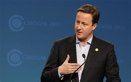 Prime Minister David Cameron holds a news conference at the Commonwealth summit in Perth