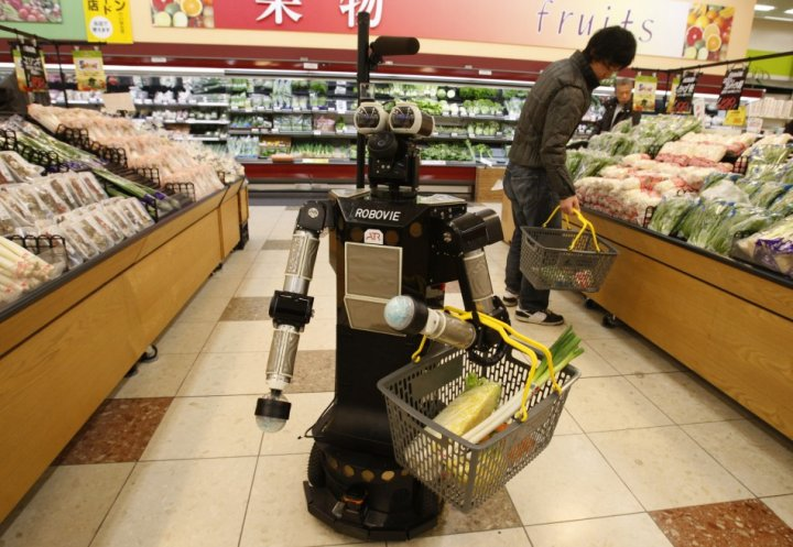 "Robot named ""Robovie-II"" moves around at a grocery store during shopping assisting experiment in Kyoto, western Japan"