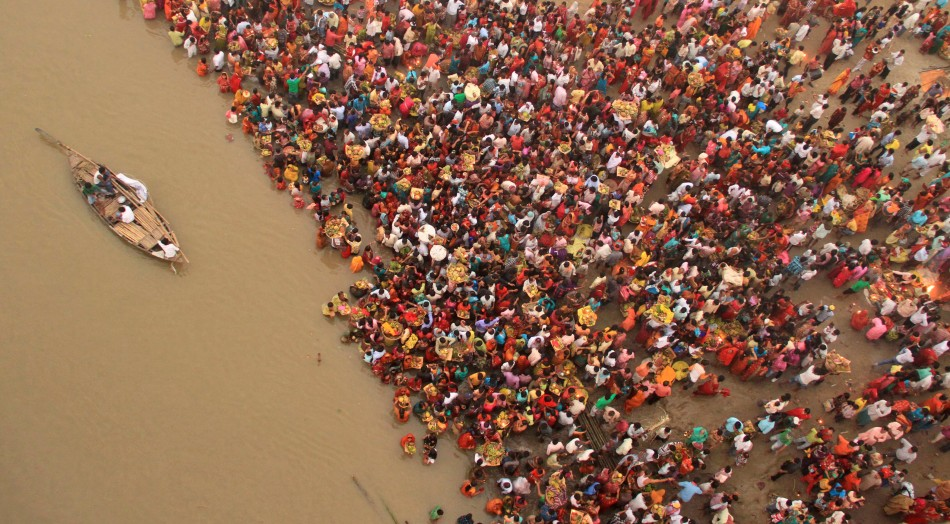 Hindu devotees gather to worship the Sun god on the banks of river Ganges during the Hindu religious festival Chhat Puja in Patna
