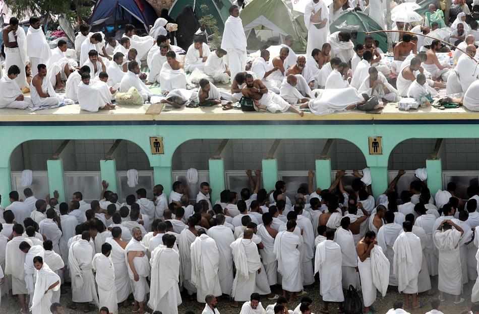 Muslim pilgrims queue to wash themselves before prayer in Arafat near Mecca.