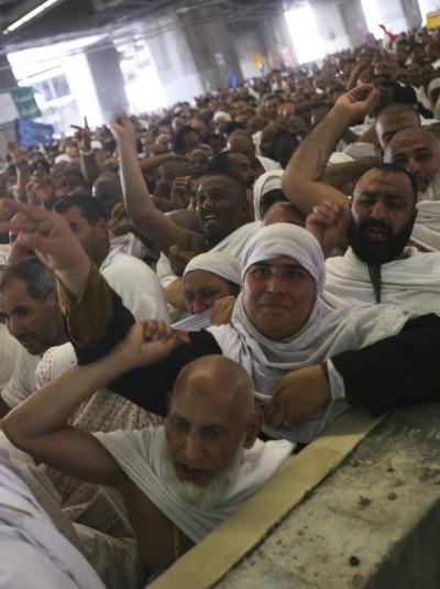 Muslim pilgrims cast seven stones at pillars symbolising Satan in Mena