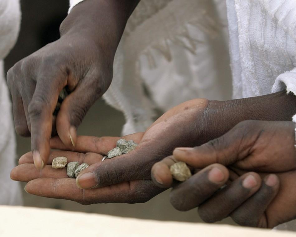 Muslim pilgrims count seven stones before throwing them at pillars symbolizing Satan in Mena, outside Mecca
