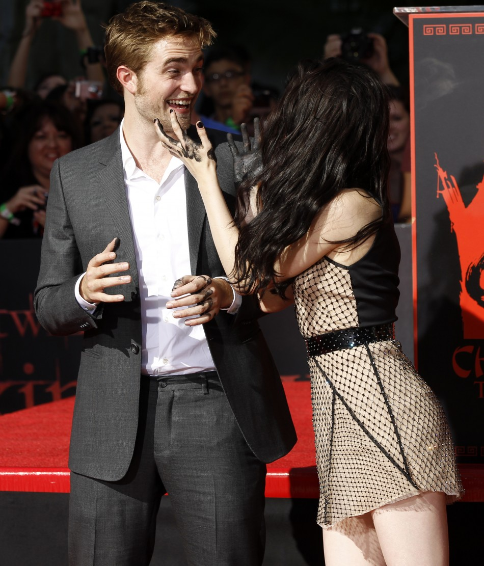 Actors Robert Pattinson and Kristen Stewart joke after leaving handprints in cement during a hand and footprint ceremony at the Grauman039s Chinese Theatre in Hollywood, California on November 3, 2011.