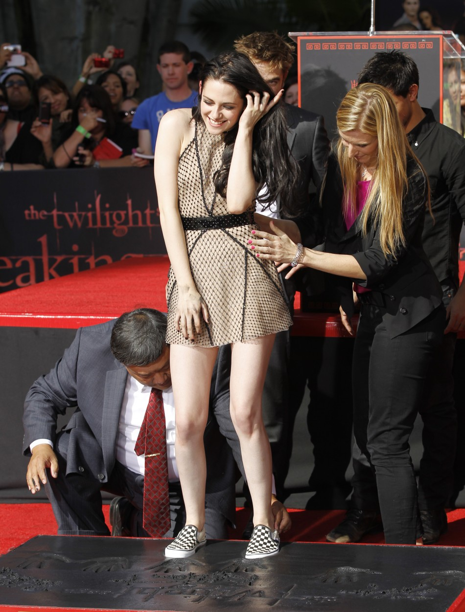 Actress Kristen Stewart puts her footprints in cement during a hand and footprint ceremony at the Grauman039s Chinese Theatre in Hollywood, California November 3, 2011.