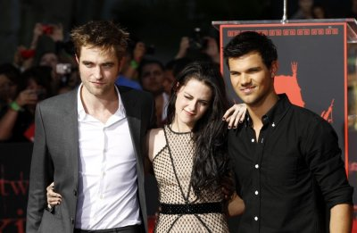 Actors Robert Pattinson left, Kristen Stewart and Taylor Lautner pose at their hand and footprint ceremony at the Grauman039s Chinese Theatre in Hollywood, California November 3, 2011.