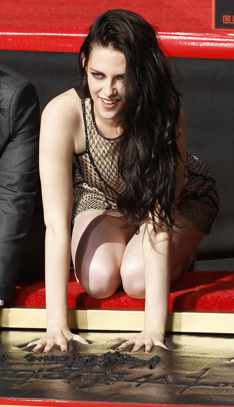 Actress Kristen Stewart puts her handprints in cement during a hand and footprint ceremony at the Grauman039s Chinese Theatre in Hollywood, California November 3, 2011.