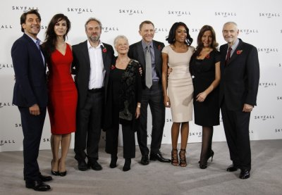 Director Sam Mendes 3rd L poses with cast members L-R Javier Bardem, Berenice Marlohe, Judi Dench, Daniel Craig and Naomie Harris along with producers Barbara Broccoli and Michael G. Wilson during a photocall to launch the start of production of the n