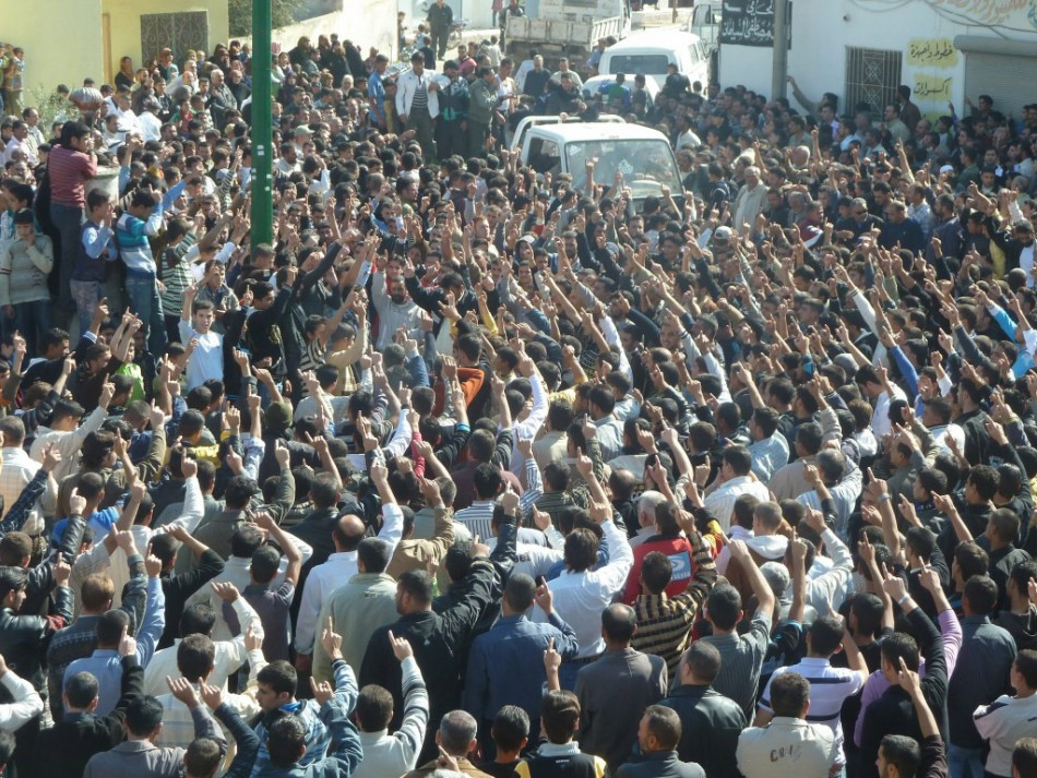 Anti-government protesters shout slogans against Syria's President Bashar al-Assad during the funeral of Sunni Muslim villagers killed on Wednesday, in Hula near Homs November 2, 2011
