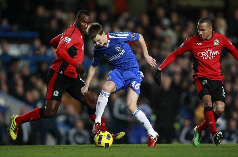 Chelsea's Josh McEachran challenges Blackburn Rovers' Jason Roberts and Martin Olsson during their English Premier League soccer match in London
