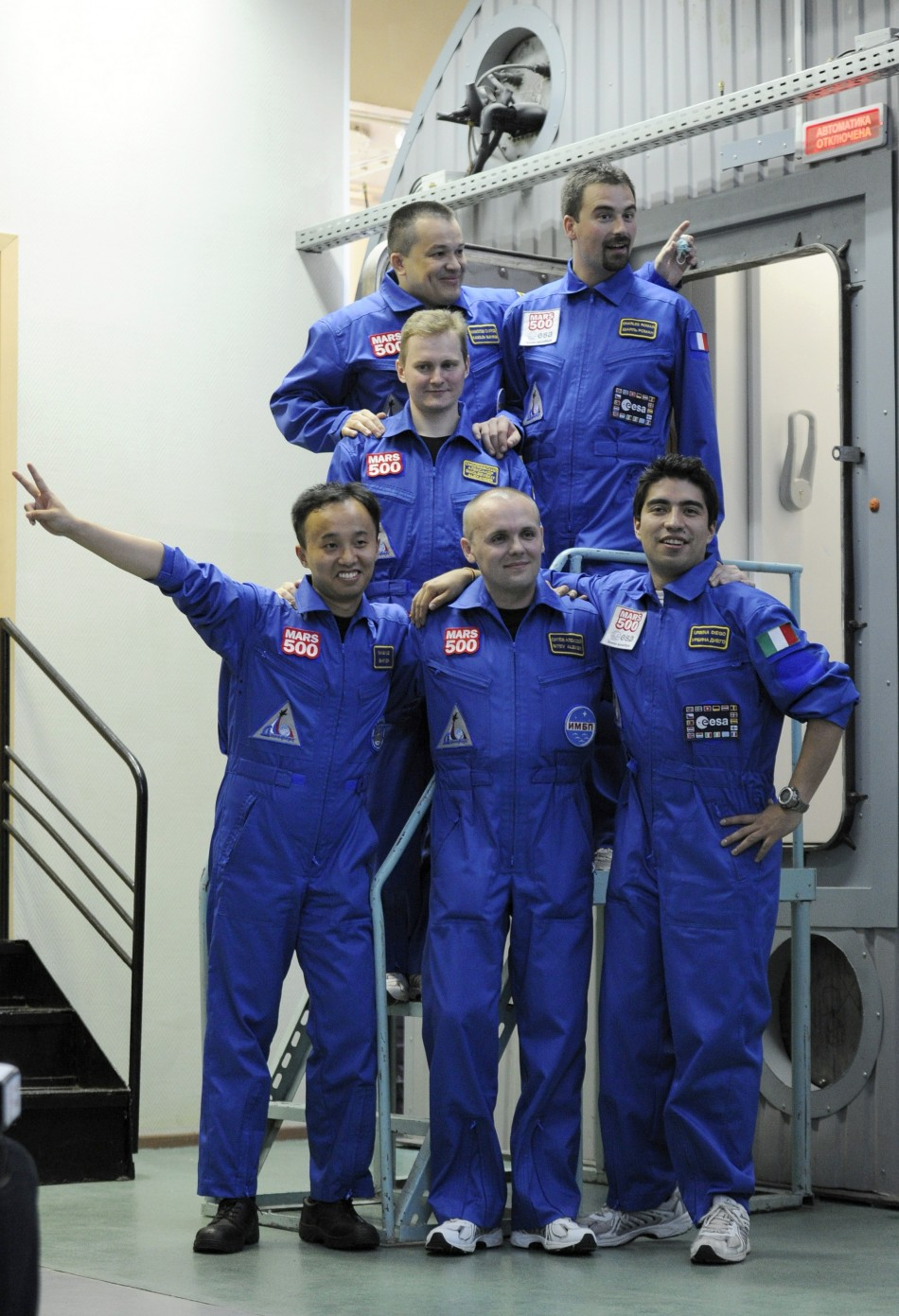 Participants of the Mars500 experiment, pose for a picture before entering a confinement module to start their mission in Moscow