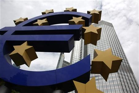 A huge euro logo stands in front of the headquarters of the European Central Bank in Frankfurt