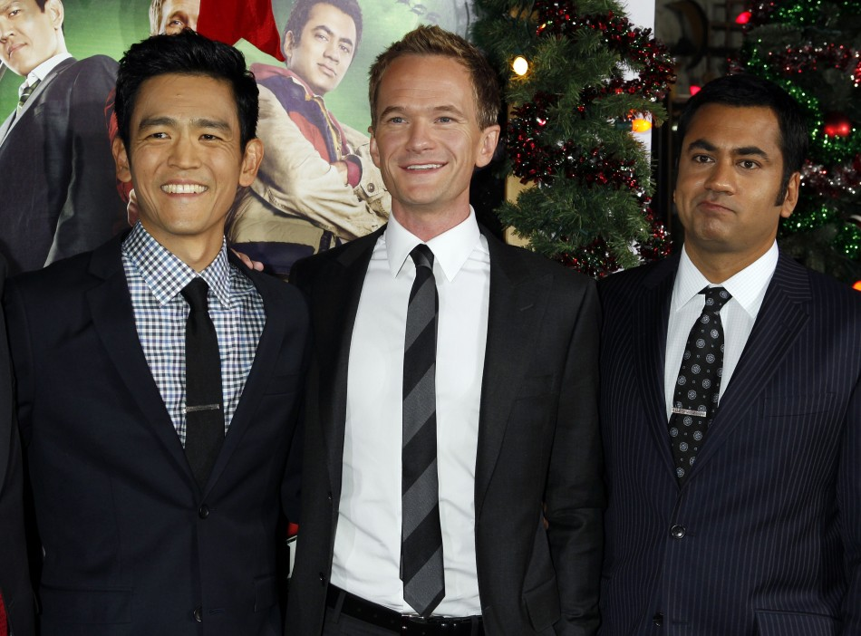 Actors John Cho, Neil Patrick Harris, and Kal Penn pose at the premiere of the new film quotA Very Harold  Kumar 3D Christmasquot in Hollywood
