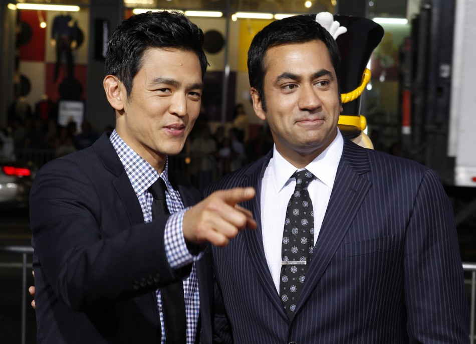 Actors John Cho and Kal Penn pose at the premiere of the new film quotA Very Harold  Kumar 3D Christmasquot in Hollywood