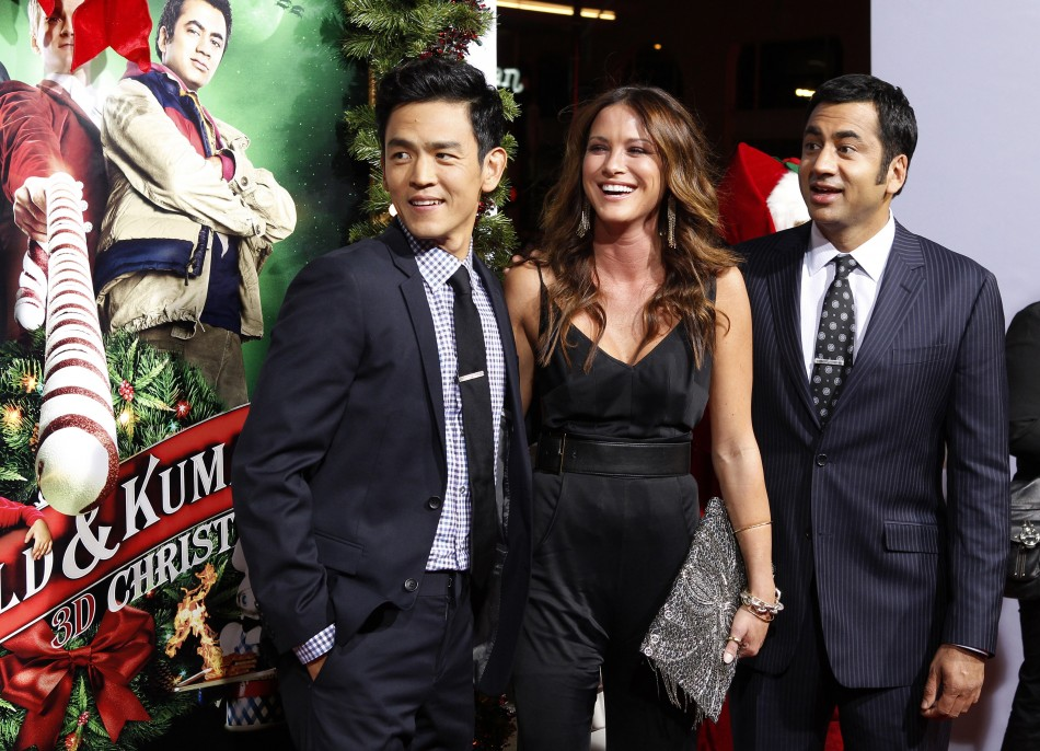 Actors John Cho, Danneel Harris and Kal Penn pose at the premiere of their new film quotA Very Harold  Kumar 3D Christmasquot in Hollywood