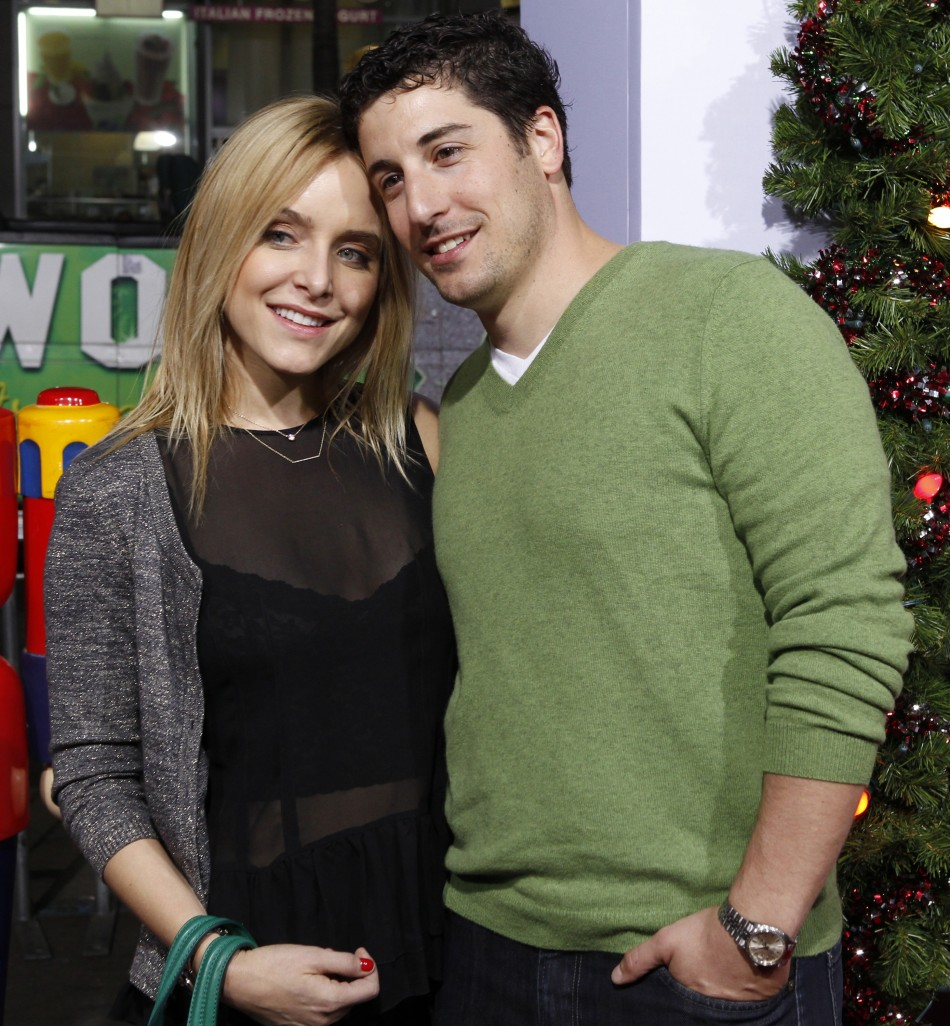 Actor Jason Biggs and wife Jenny Mollen pose at the premiere of the new film quotA Very Harold  Kumar 3D Christmasquot in Hollywood