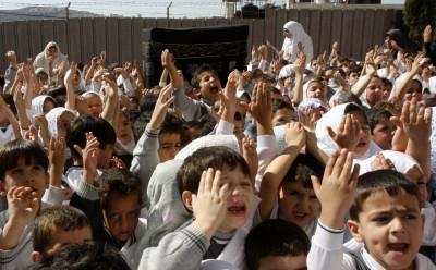 Palestinian schoolchildren simulate the annual Muslim pilgrimage of Hajj, at their school in Nablus