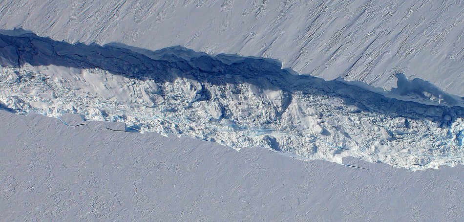 a close-up view of the crack spreading across the ice shelf of Pine Island Glacier, with details of the boulder-like blocks of ice that fell into the rift when it split