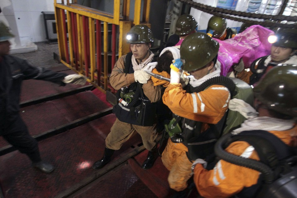 Rescuers carry out an injured manner after an explosion in a mine in the Sanmenxia Mine in Hennan province in 2011. (Reuters)