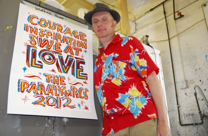London 2012 Paralympic poster designer Bob and Roberta Smith with his poster Love